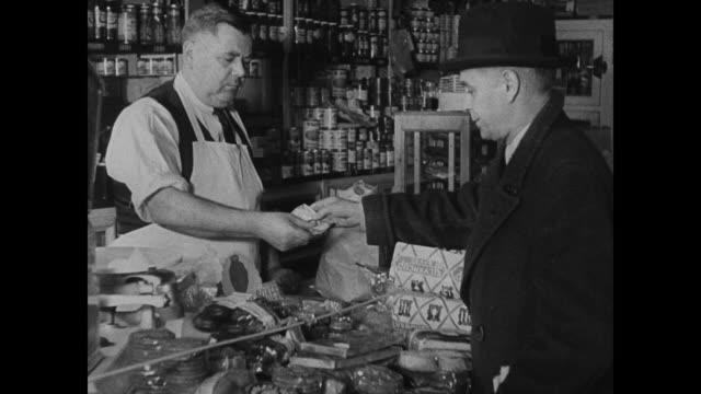 william watts in grocery store handing bills money to clerk cu clerk giving back change cu card 'warning dangerous counterfeit $20 federal reserve... - 1937 stock videos and b-roll footage