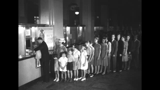 vídeos de stock e filmes b-roll de william white assists his 16 children at post office window as they buy defense stamps inside benjamin franklin station post office sign at window... - benjamin franklin portrait