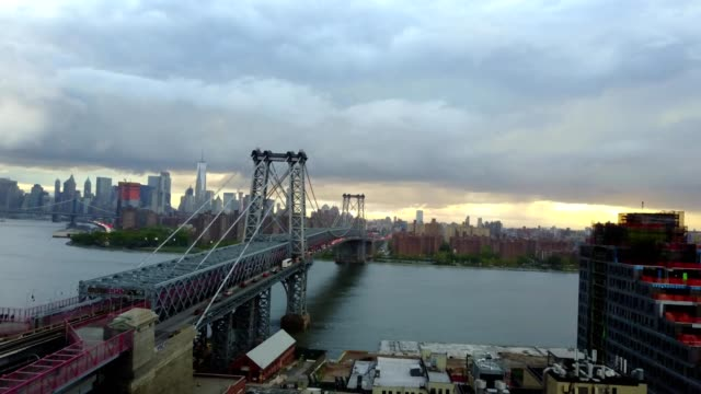 williamsburg bridge, river and city skyline - williamsburg bridge stock videos and b-roll footage