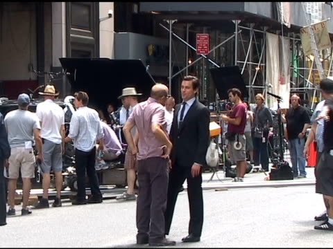 willie garson and matt bomer share a laugh between takes on the set of 'white collar' in new york 06/30/11 - white collar worker点の映像素材/bロール