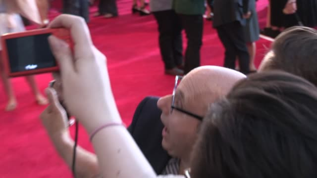 willie garson greets fans at the alexander and the terrible, horrible, no good, very bad day premiere in los angeles in celebrity sightings in los... - ウィリー ガーソン点の映像素材/bロール