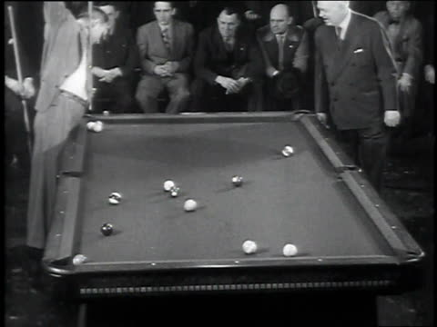 willie mosconi holding cue stick vertically / ball crosses table with tremendous spin sinking shot - cue ball stock videos & royalty-free footage