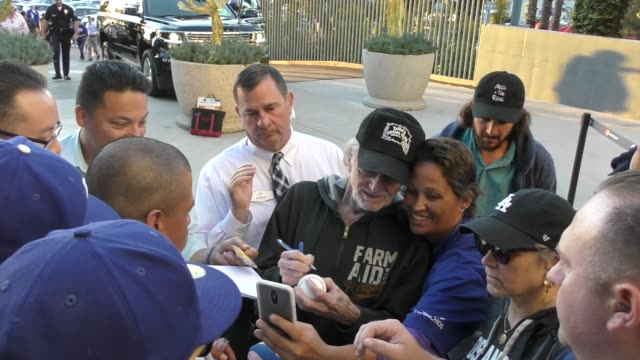 willie nelson greets fans outside the dodgers vs. brewers nlcs game 4 playoff at dodger stadium in los angeles in celebrity sightings in los angeles, - willie nelson stock-videos und b-roll-filmmaterial