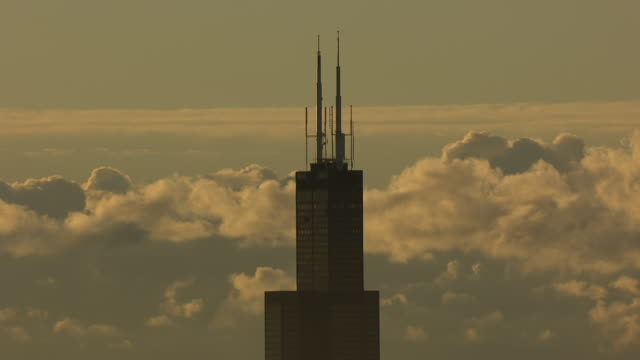 WS ZI AERIAL POV Willis Tower with clouds in background / Cook County, Illinois, United States