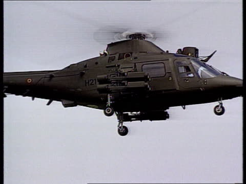 defence scandal willy claes defence scandal ext g/a agusta military helicopter hovering lms two helicopters hovering in display g/a helicopter... - hovering stock videos & royalty-free footage