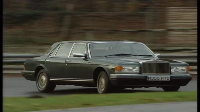 willy hoy drives a rolls royce - rolls royce stock videos and b-roll footage