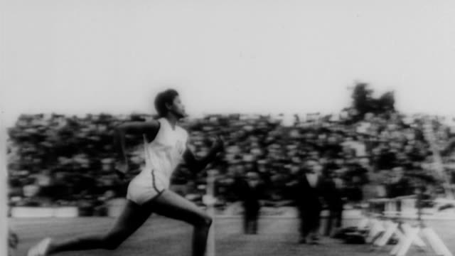 wilma rudolph running down the track / ralph boston performing the long jump / frank budd record breaking run at aau championships successful track... - world record stock videos & royalty-free footage