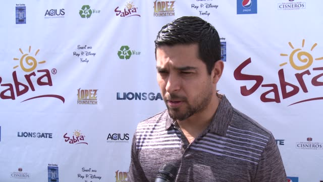 interview wilmer valderrama on being a part of the afternoon at the 7th annual george lopez celebrity golf classic presented by sabra salsa at... - wilmer valderrama stock videos and b-roll footage