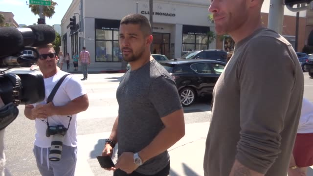 interview wilmer valderrama talks about the connor mcgregor vs floyd mayweather jr fight deadline while shopping in beverly hills in celebrity... - wilmer valderrama stock videos & royalty-free footage