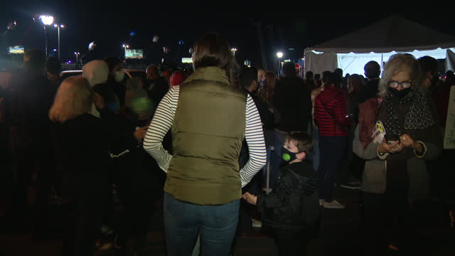 wilmington, de, u.s. - crowds gathered outdoors to hear live broadcast of biden's victory speech, on saturday, november 7, 2020. reactions three days... - live broadcast stock videos & royalty-free footage