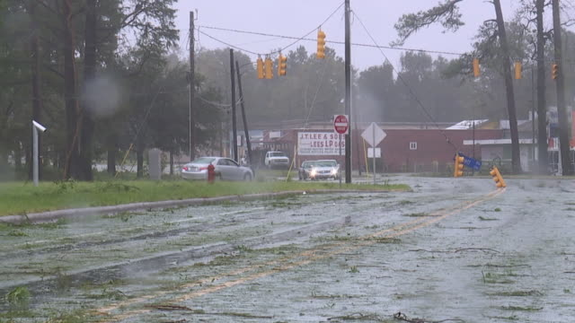 wilmington, nc, u.s., damages on streets during hurricane florence, on friday, september 14, 2018. - power line stock videos & royalty-free footage