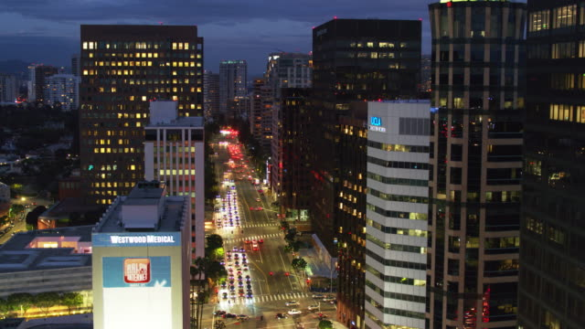 wilshire blvd, los angeles at night - descending drone shot - westwood neighborhood los angeles stock videos & royalty-free footage