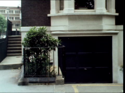 gv street tms terraces pan to no15 gv terraced houses ms door of no 14 ms garage in basement ms plants and fence pan to park gv park across road gv... - basement stock videos and b-roll footage