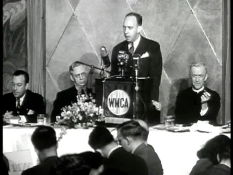 stockvideo's en b-roll-footage met wilson wyatt standing behind wmca podium speaking about housing shortage 'must be donewill be done' audience applauding - 1946