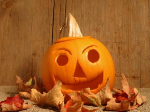 t/l cu wilting pumpkin with jack o' lantern face  - pumpkin stock videos & royalty-free footage