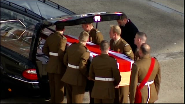 lyneham: ext union jack draped coffin of guardsman christopher davies carried off hercules plane as last post played by army bugler sot coffin lifted... - union army stock videos & royalty-free footage