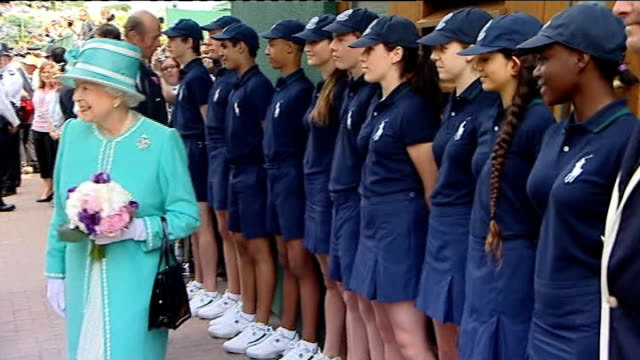 queen elizabeth ii visit queen along and chatting to ball boys and girls in lineup / queen meeting lineup of former and current tennis players... - andy roddick stock-videos und b-roll-filmmaterial