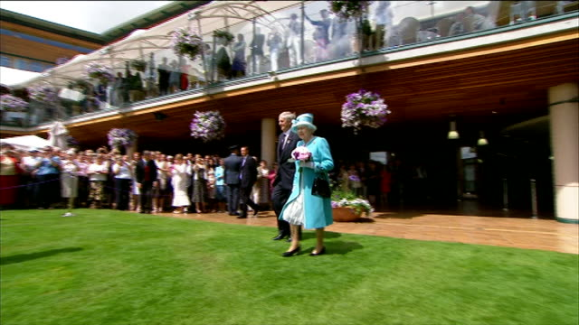 queen elizabeth ii visit queen towards past crowds / queen along past ball girls ball boys linesmen and lineswomen / queen arriving at grass area and... - andy roddick stock videos and b-roll footage