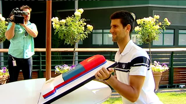 Novak Djokovic celebrates victory and being world number one photocall and interview ENGLAND London Wimbledon All England Club EXT Novak Djokovic...