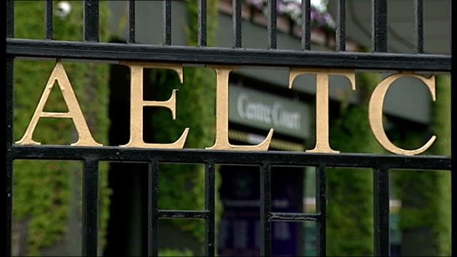 Rufus the hawk stolen Wimbledon EXT 'Centre Court' sign seen through gates