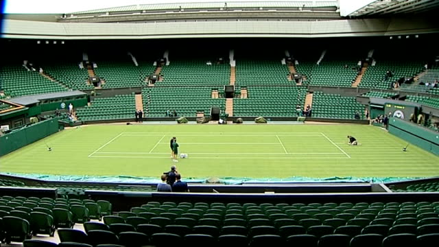 first round rafael nadal knocked out / andy murray through england london wimbledon ext wide shot groundsmen working on centre court man working on... - ground staff stock videos & royalty-free footage