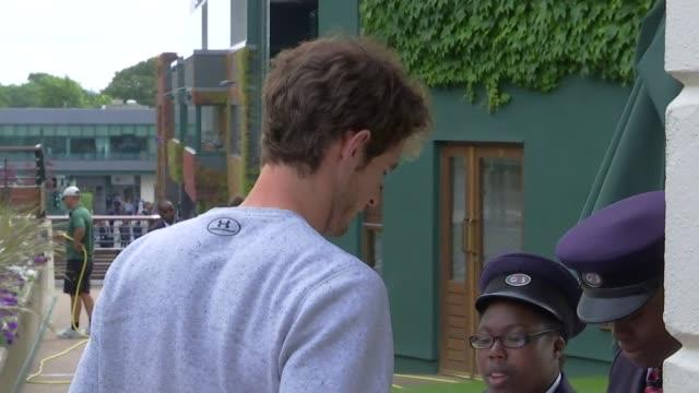 Andy Murray arrival ENGLAND London Wimbledon All England Lawn and Tennis Club EXT Andy Murray along through security
