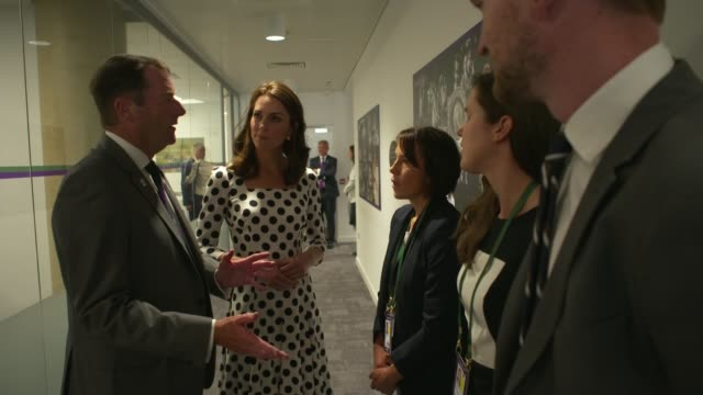 duchess of cambridge visit wide shot al england tennis club court gvs ball boys and girls playing table tennis in communal room / catherine duchess... - court room stock-videos und b-roll-filmmaterial