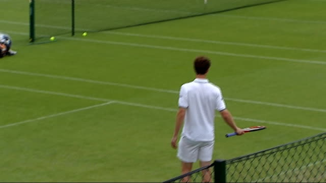 stockvideo's en b-roll-footage met general views centre court and andy murray various shots of andy murray practicing on grass court - number 1
