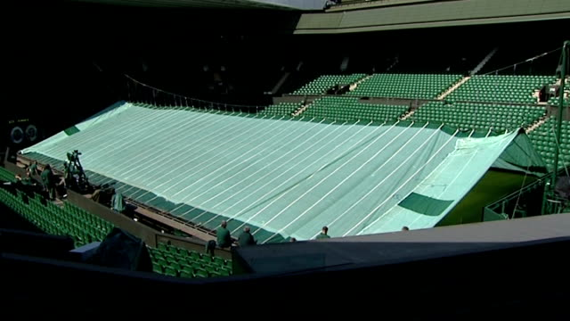 general views centre court and andy murray england london wimbledon all england lawn tennis club ext general view empty centre court as protective... - general electric building stock videos and b-roll footage