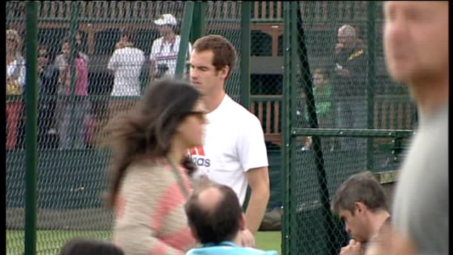 wimbledon championships begin; andy murray stretching murray spinning racquet - racquet stock videos & royalty-free footage