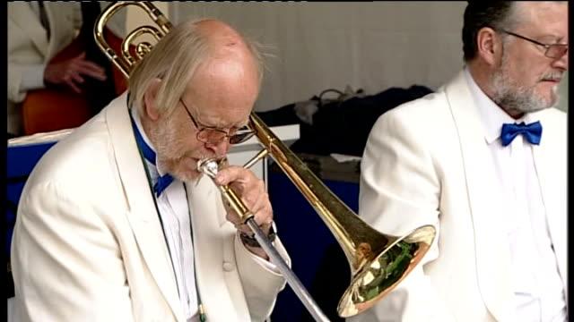 wimbledon championships begin; man playing a trombone brass band playing - ブラスバンド点の映像素材/bロール
