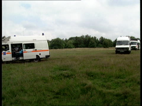 London Wimbledon EXT LS Police vans on common along PAN RL Police in overalls along into woodsPAN LR to BV LS Police in woods checking ground MS Ditto
