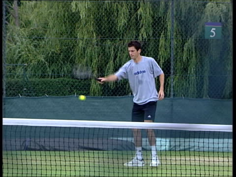 day 5 henman tickets cut/ andy roddick ms tim henman practising wimbledon i/c - andy roddick stock-videos und b-roll-filmmaterial