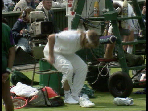 wimbledon england london wimbledon andre agassi amp grant connell along out onto court ms both turn to bow to royal box tbv both along ms agassi... - tracksuit bottoms stock videos & royalty-free footage