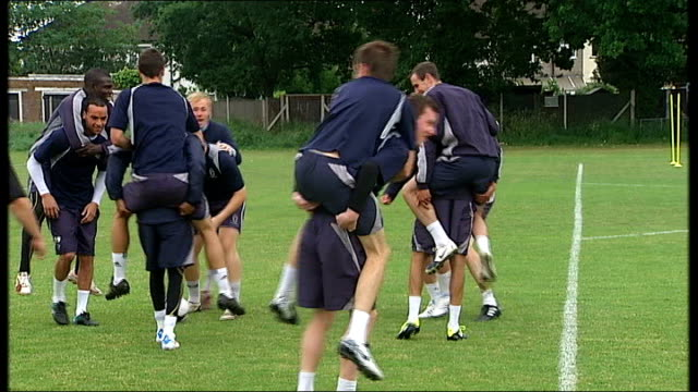 AFC Wimbledon face promotion to Football League ENGLAND London New Morden Wimbledon team in training as some players jump on backs of other players...