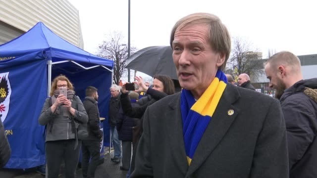 AFC Wimbledon givern permission to build new stadium at Plough Lane Merton EXT Cllr Stephen Alambritis and Wimbledon AFC supporters photocall...