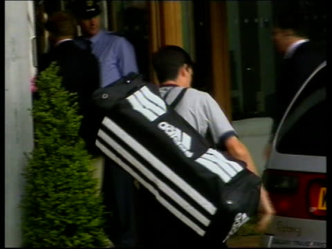 itn england london wimbledon ext tim henman from car and placing bag to be searched - itv evening bulletin stock videos & royalty-free footage