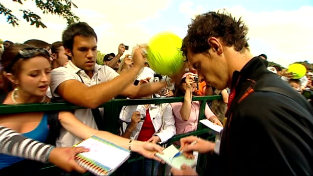 Day One ENGLAND London All England Tennis Club EXT Andy Murray along and signing autographs for fans Andy Murray interview SOT Murray practising PULL...