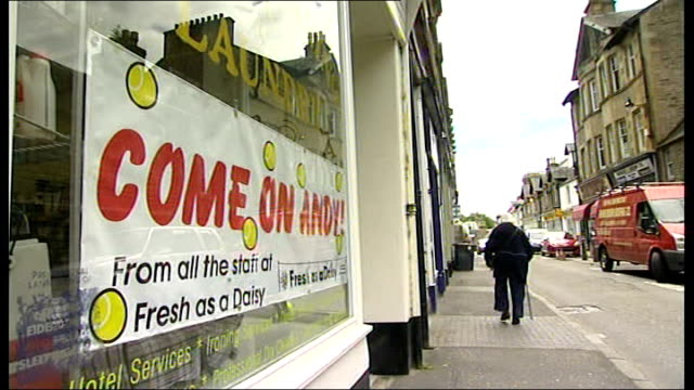 nadal and djokovic reach men's final; scotland: dunblane: ext/int various signs around andy murray's hometown expressing the towns people's support... - ダンブレーン点の映像素材/bロール