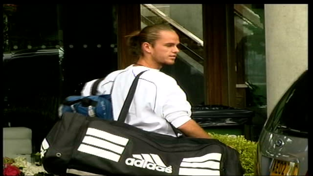 player arrivals:; england: london: wimbledon: all england lawn tennis club: ext david nalbandian along past and thru to gates, xavier malisse unloads... - serena williams tennis player stock videos & royalty-free footage
