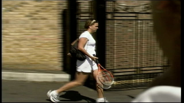 player arrivals; itn england: london: wimbledon: ext tennis player as crosses road and into tennis ground as bags checked by security / lyndsay... - personal land vehicle stock videos & royalty-free footage