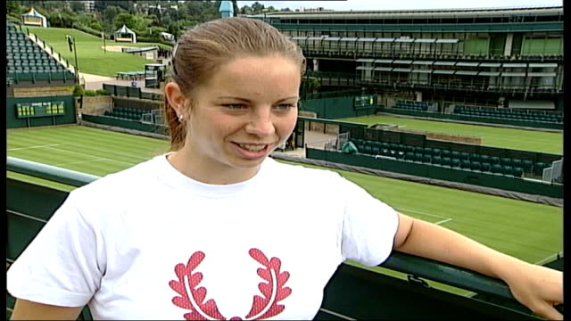 british hopes; itn england: london: wimbledon: ext katie o'brien walking along & practising on tennis court katie o'brien interview sot - trying to... - international tennis federation stock videos & royalty-free footage