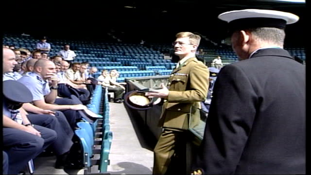 wimbledon preview; itn england: south london: wimbledon: ext side armed forces officer addressing forces volunteers sot - we are in uniform, we are... - international tennis federation stock videos & royalty-free footage