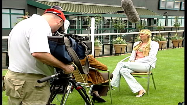 reigning women's champion maria sharapova interview england london wimbledon ext maria sharapova wearing trouser suit and headscarf sitting chatting... - maria sharapova stock videos and b-roll footage