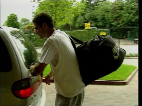 wimbledon starts tomorrow lib ms pete sampras closing boot of car away - pete sampras stock videos & royalty-free footage