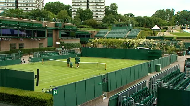 wimbledon tournament 2011 preview; various views of greenkeepers and other wimbledon workers checking net tension general views of other tennis... - international tennis federation stock videos & royalty-free footage