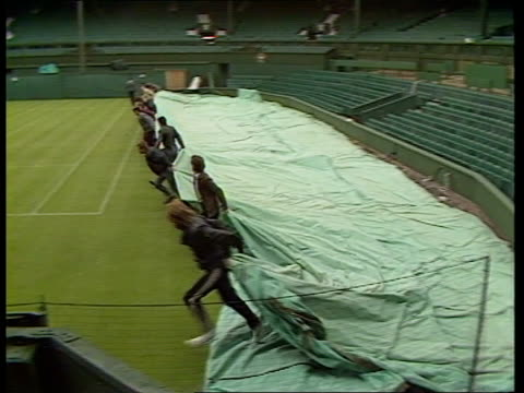 wimbledon tournament preparations a london wimbledon all england club ext lms four women playing on grass court ms ditto ms umpire ms ladies... - ground staff stock videos & royalty-free footage