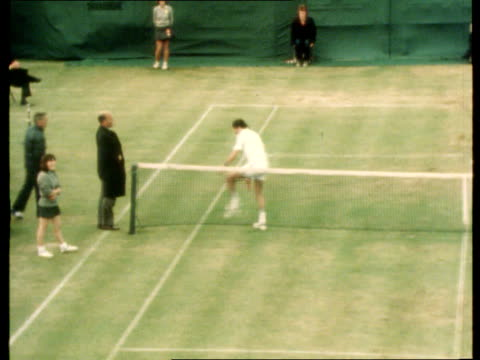 touts and tennis htv tlms nastase on court taking off trainers as arguing with an official - shoes in a row stock videos & royalty-free footage