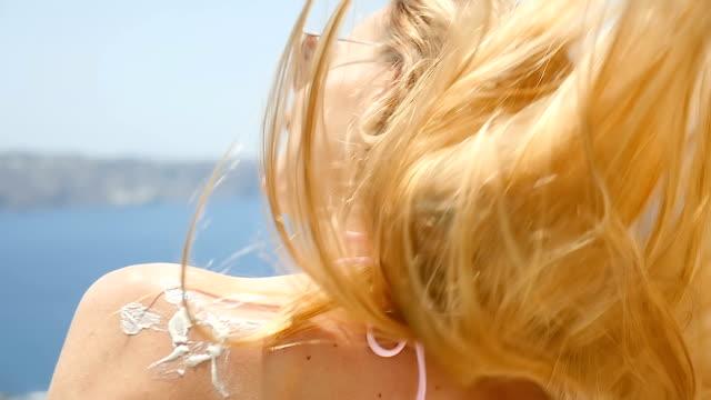 win & sun & suntan lotion - sun cream stock videos and b-roll footage