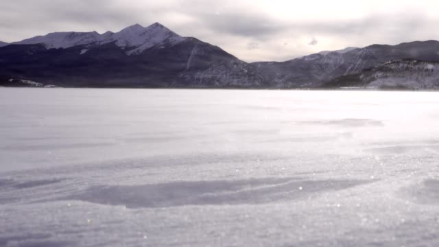 wind and blowing snow on frozen lake - gore range stock videos and b-roll footage